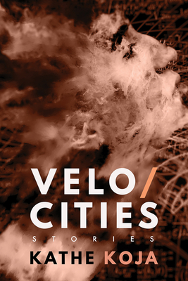 Book cover: Velocities: Stories, Kathe Koja.  The photograph of a young adult's face among grass is superimposed over a texture like fire, smoke, or clouds, creating a fuzzy, strange image.