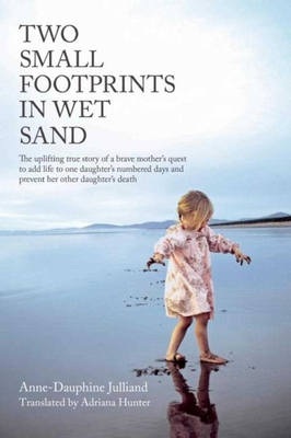 Two Small Footprints in Wet Sand Cover