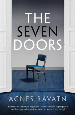 Book cover: The Seven Doors. Behind two white doors, a blue chair stands in the middle of a blue floor.