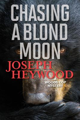 Chasing a Blond Moon: A Woods Cop Mystery Cover Image