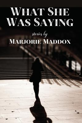 Cover for What She Was Saying