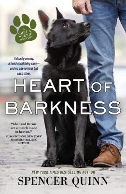 cover art for Heart of Barkness, cover shows an alert black German Shepherd dog looking up at a man next to it