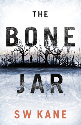 Book cover: The Bone Jar.  Across an icy pond is a person standing among a grove of gnarled trees, silhouetted against a white sky.
