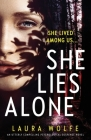 She Lies Alone: An utterly compelling psychological suspense novel Cover Image