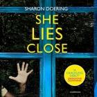 She Lies Close Cover Image