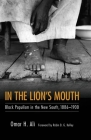 In the Lion's Mouth: Black Populism in the New South, 1886-1900 Cover Image
