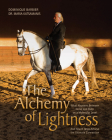 The Alchemy of Lightness: What Happens Between Horse and Rider on a Molecular Level and How It Helps Achieve the Ultimate Connection Cover Image