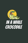 In A While Crocodile: Blank Lined Notebook Cover Image