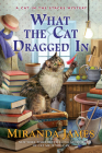What the Cat Dragged In (Cat in the Stacks Mystery #14) Cover Image