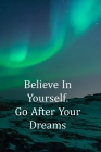 Believe in Yourself. Go After Your Dreams: College Ruled Notebook - With Inspirational Quotes On Each Page - Dramatic Green Northern Lights Cover Image