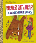 Never Pat a Bear: A Book About Signs (Little Golden Book) Cover Image