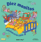 Diez Monitos Saltaban en la Cama = Ten Little Monkeys Jumping on the Bed (Classic Books with Holes Board Book) Cover Image