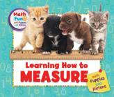Learning How to Measure with Puppies and Kittens (Math Fun with Puppies and Kittens) Cover Image