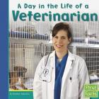 A Day in the Life of a Veterinarian (First Facts: Community Helpers at Work) Cover Image