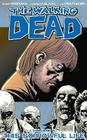 The Walking Dead Volume 6: This Sorrowful Life (Walking Dead (6 Stories) #6) Cover Image