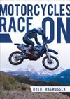Motorcycles Race on Cover Image