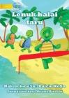 Tawa the turtle in a race (Tetun edition) - Lenuk halai taru Cover Image